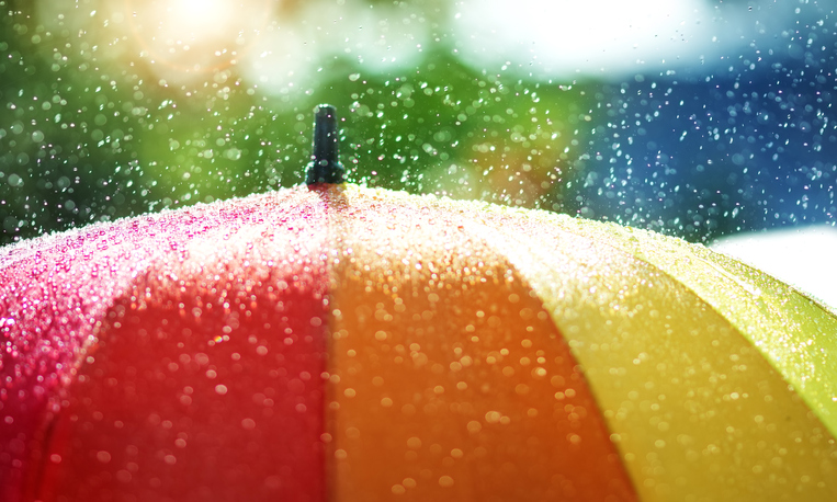 Water droplets falling on an umbrella.
